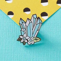 Blue Floral Crystals Enamel Pin, with butterfly clutch on the reverse. Teeny enough to adorn your bag, lapel, pocket or whatever you fancy. Hand designed here in the UK, and manufactured in exclusive low quantities. This pin measures 25mm high, and is made from lovely smooth enamel for a hard wearing finish.