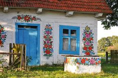 Zalipie, Poland; People still paint their cottages with traditional floral motifs. (I'd like to try this on a garden shed.)