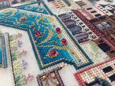 Medieval Town Mandala | Flickr - Photo Sharing! A Chatelaine design stitched by Helen Orlova - the fine details are amazing.