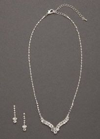 "Curved V-shape crystal necklace and earring set is sophisticated and refined.  Elegant curved V-shape necklace is sophisticated and lays beautifully.  Drop earrings feature crystal clusters for a dazzling effect.  Necklace measures approximately 16"" long with 3"" extender.   Imported.  Availble in Silver."