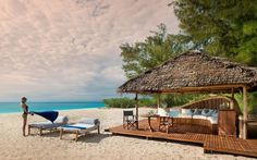 &Beyond Mnemba Island is a renowned & exclusive beach paradise northeast of Zanzibar Archipelago. It's a private island in Tanzania famous for its luxury lodge. Zanzibar Beaches, Island Resort, Travel And Leisure, Hotels And Resorts, Lodges, Beautiful Beaches, Places To Go, Around The Worlds, Luxury