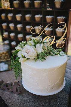 Gold laser cut cake topper. Buttercream cutting cake. Beautiful blooms. Gold and white. Cupcakes in a crate. Photo by Merge Photography