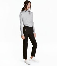 Black. Dress pants in woven fabric with a hook-and-eye fastener and zip fly. Diagonal front pockets with zip, welt back pockets, and tapered legs with