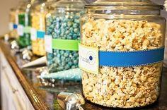 popcorn bar at wedding reception | blue and yellow popcorn buffet