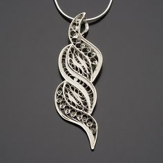 Sterling silver pendant handmade in Peru by fair trade artisans. Price: $40  Olina Faire... a World of reasons to Party! www.olinafaire.com