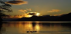 Taken from near Dores.   During the winter months the sun sets right down the other end of Loch Ness from Dores, meaning amazing sunsets on most clear day