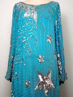 ❖ What a gorgeous vintage dress! Its beautifully embellished with silver sequins and glass beads on the most amazing color!  ❖ Material: Silk and Rayon  ❖