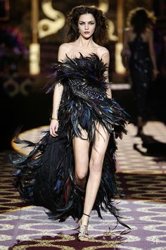 #CavalliArchive - The amazing Mariacarla Boscono shows her fierce runway walk at the #RobertoCavalli FW 2004-05 fashion show!