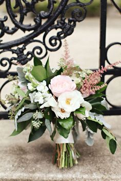 white and pink wedding bouquet with greenery and seeded eucalyptus