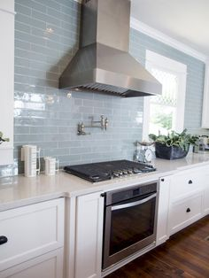 MUST HAVE BLUE SUBWAY TILE fir the kitchen! features in the new kitchen are stainless steel appliances, vent hood and a subway tile backsplash in muted blue – a favorite color of homeowner, Jessica. Blue Subway Tile, Subway Tile Kitchen, Blue Kitchen Tiles, Blue Tiles, Colourful Kitchen Tiles, Subway Tile Colors, Colorful Kitchens, Kitchen Black, Color Tile