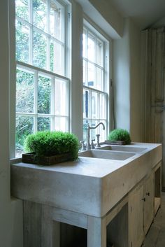 Bespoke solid double pantry sink unit carved from a single block of Roche Marron Limestone from Artisans of Devizes