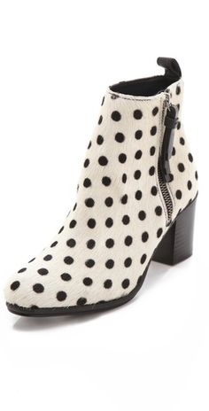 Playful polka dots on sleek haircalf breathe new life into the classic bootie silhouette. The back is trimmed with solid leather and a pull tab, and the outer side has an exposed zip with a leather pull.