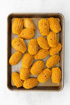 Pumpkin Madeleines - A simple french madeleine recipe with a fall twist! Light and fluffy homemade madeleines made with pumpkin and fall spices! Starbucks Copycat Recipe | Pumpkin Madeleines | Madeleine Recipe #dessert #baking #recipe #easyrecipe #easydessert #pumpkin #fall #starbucks #copycat Pumpkin Pie Spice, Pumpkin Puree, Madeline Cookies Recipe, Madeleine Recipe, Halloween Sweets, Copycat Recipes, Easy Desserts, Cookie Recipes, Spices