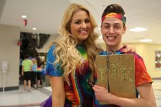 Raquel Sain (left), a third-year in strategic communication, poses with Travis Bihn, a third-year in psychology and theater, during BuckeyeThon on Feb. 6 at the Ohio Union. Sain and Bihn served as student emcees for the dance marathon's opening ceremonies. Credit: Muyao Shen / Lantern photographer