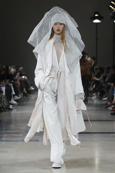 Over the past seasons, Sebastien Meunier has proved to be strong supporter of Ann Demeulemeester's signature style: he remained faithful to the Edwardian jackets, billowing layering, slim pants...