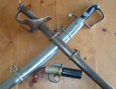 "Prussian heavy cavalry sabre, chemically browned steel guard and scabbard, 1850's. P1796 British light cavalry sabre, simple steel ""stirrup"" guard, heavy curved blade. Replica Blissett ""improved revolving pistol"" or pepperbox."