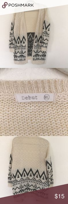 Créme/ivory and Black throw sweater. Creme/ivory excellent condition throw sweater. Red louse crop under for sale also. Sweater is warm and comfy! Sweaters Shrugs & Ponchos