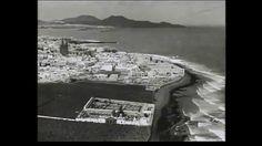 """IMÁGENES AÉREAS DEL TEIDE Y LAS PALMAS EN LOS AÑOS 30 DEL SIGLO XX. Locución en alemán. El Club de Investigación Histórica del Instituto Pérez Minik y ACDLSDA (Asociación Cultural """"Desde La Sombra Del Almendro"""") encuentran en esta ocasión imágenes aéreas del Teide y de Las Palmas de Gran Canaria. Es probable que sean del año 1932. En las imágenes de Las Palmas se ve el antiguo cementerio de Vegueta, las playas, Guanaterme, el Puerto de La Luz y Las Palmas y muchos más detalles."""