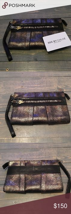 🎯 See by Chloe Wristlet-Metallic Brn/Gld NWOT NWOT: See By Chloe Wristlet/Wallet. Perfect for a night out. Will easily hold all credit cards/cash/coins/phone and even a lipgloss! One side holds credit cards backed by an empty slot, the other side has an empty slot. Middle pouch is zippered for coins or anything else! Outside detail includes a zipper in the front and black leather band in the back. Multi-colored hardware! Includes authenticity card and dustbag. See by Chloe Bags Wallets