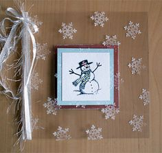 By ulrika_m at Splitcoaststampers. Acetate folded, stamped on front with white StazOn. Snowman stamped, colored, and matted. This piece was adhered inside the card front. A piece the same size was adhered inside the card back to hold the sentiment.