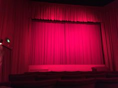 Old fashioned night at the movies on our honeymoon including an intermission and ice cream half way through the movie - token red curtain fabric everywhere!!!