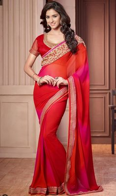 Transform your onlookers into admirers donning this scarlet and pink color shade georgette sari. The lace, resham and stones work seems to be chic and aspiration for any event. #traditionalsaree #trendysaris #redcolorsarees