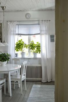 Charming window dressing using cheer linen curtains combined with a pull-up gingham blind