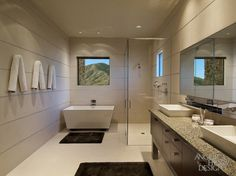 A contemporary bathroom with a trapezoid shaped tub, glass shower enclosure and dark brown rugs in front of the sink and bathtub by Angelica Henry Design. Contemporary Interior Design, Contemporary Bathrooms, Modern Bathroom, Home Interior Design, Small Bathroom, Master Bathroom, Bathroom Showers, Bathroom Vanities, Bathroom Kids