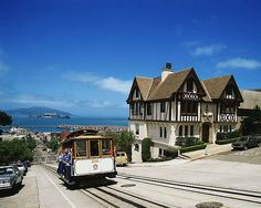 A cable car trekking up a steep hill in Russian Hill #SanFrancisco #SF