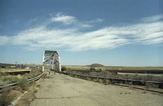 """Route 66 - Big sky over abandoned Rio Puerco bridge, an old Rt. 66 river crossing. Built in 1933 near the city of Albuquerque, the interstate now runs along side it. """"The Fine Art Photography of Frank Romeo."""""""
