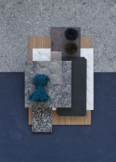 Material board. I like the dark moody blues and stone finishes along side the natural wood grain flooring.
