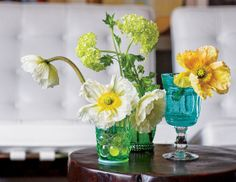 Mismatched water glasses give these blooms a cheerful, easy feeling which is casual and funky!