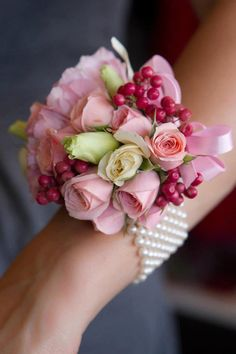 Gorgeous wrist corsage.  Bring out your inner Princess, floral jewelry is super hot this Prom Season!  We can replicate your favorite designs and match your corsage to your dress.  Find us at www.flowersofcharlotte.com