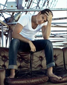 boy in dark jeans and a white t