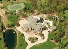 Eminem now calls the town of Rochester, Michigan home. Eminem's Rochester home - which sits on over 5 acres - offers six bedrooms, seven bathrooms, tennis court (converted to a basketball court), swimming pool and a large oval-shaped pond. Celebrity Mansions, Celebrity Houses, Celebrity Guys, Rochester Homes, Rochester Michigan, Eminem Net Worth, Billionaire Homes, Mansion Plans, Haus