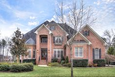 Impeccably maintained custom brick home with pool and spa overlooking the golf course in #RiverRun. Open floor plan with over 5,500 square feet, first floor master suite, second floor bonus room, and finished basement with rec room, bar, and billiards room.  