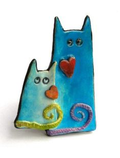 Christine Pecaut's adorable, whimsical faux ceramic polymer cats with hearts, as seen on The Polymer Arts blog, www.ThePolymerArts.com.