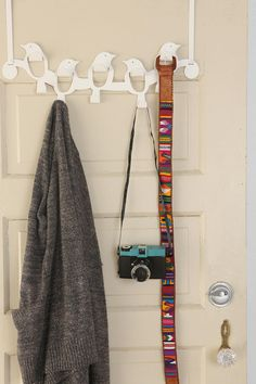 ooh this will definitely come in handy - the hubby is always hanging things behind our door and our current two hooks never seem enough!    Over the Door Flock of Birds Hook