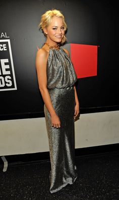 Pin for Later: 79 Big Reasons to Celebrate Emma Stone's Style We love the look of metallic for evening; Emma stunned in this silvery Balenciaga gown at the 2011 Critics' Choice Awards.