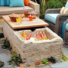 Outdoor cooler and table; convert the space under the table into a fire pit for when it's not being used as a table and you can have it all.