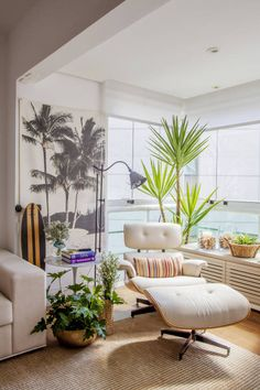Salones de estilo tropical de Helô Marques Associados
