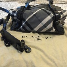Burberry bag satchel and crossbody Like new Authentic Burberry nylon black bag only worn a few times! Can be worn as a satchel or crossbody. Has 2 separate zipper  compartments. Comes with dust bag and authenticity card! Burberry Bags Satchels