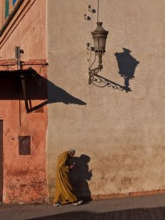 Shadows of the man, lamp, and porch indicate that the direction of the sun is coming from behind the subject. East Africa, North Africa, Learning To Love Again, Terracota, Le Far West, Moroccan Style, Moorish, Casablanca, Street Photography