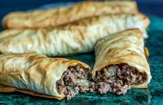 Burek recipe: A very easy step by step recipe for a Serbian style meat or cheese filled pastry, made with phyllo dough. This popular dish can be enjoyed with a side of yogurt. Also called borek. Armenian Recipes, Turkish Recipes, Greek Recipes, Bosnian Recipes, Armenian Food, Ethnic Recipes, Phyllo Dough Recipes, Onigirazu, Middle Eastern Recipes