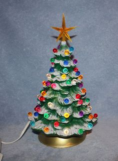 reserved for amanda handpainted ceramic lighted christmas tree covered in little round multi colored bulbs with snow tipped branches - Christmas Ceramics