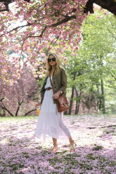 Perfect spring outfit via @Blair R Eadie // Atlantic Pacific #streetstyle // Long white dress, military jacket, neutral flats