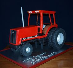 3D Allis-Chalmers 8010 tractor cake - The body of the tractor was all cake, and part of the back wheels was cake; the rest of the wheels were made of cereal treats.