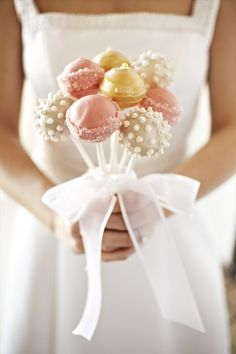 These probably taste as great as they look! Who says baking isn't art? | Cake pops for spring weddings!