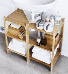 Make the most of your space! Use the neglected space under the sink by putting two RÅGRUND shelves together.