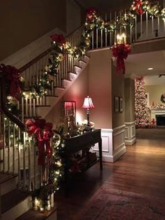 Im a classical Xmas person, red-green are warm colors for this magical time. Beautiful decor for a 2 story houses .